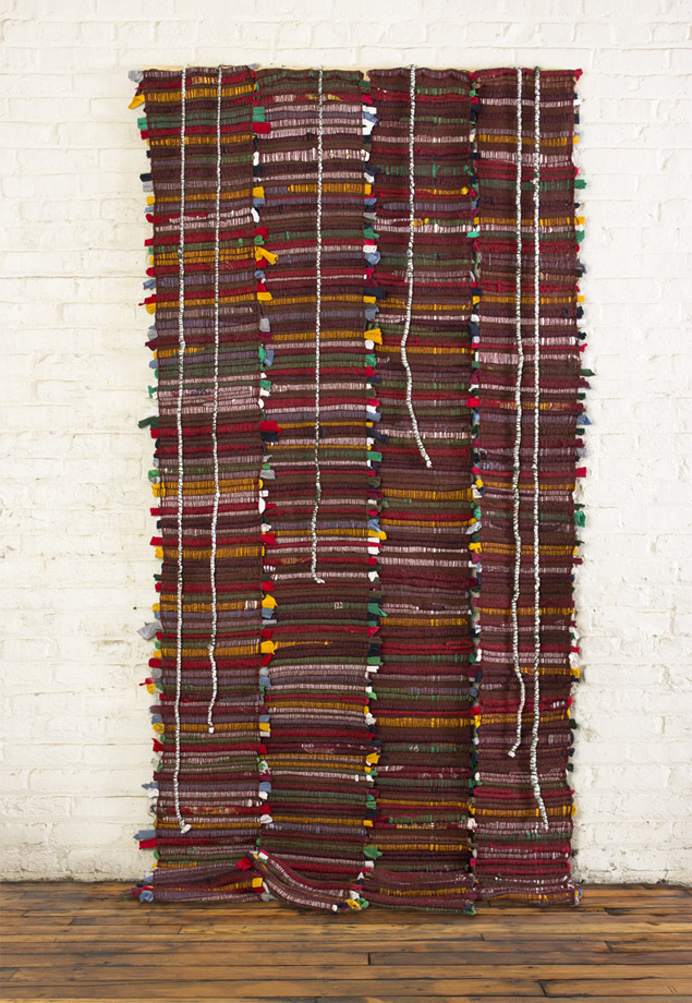 "<em>Bill, 28 handwoven t-shirts and yarn, 78x45"", 2014. </em>"