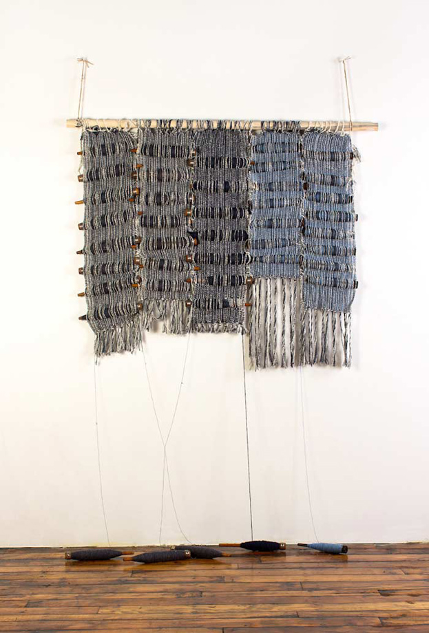 "<em>Amy 2, Bobbins and handwoven fabric, 36x48"", 2013. </em>"